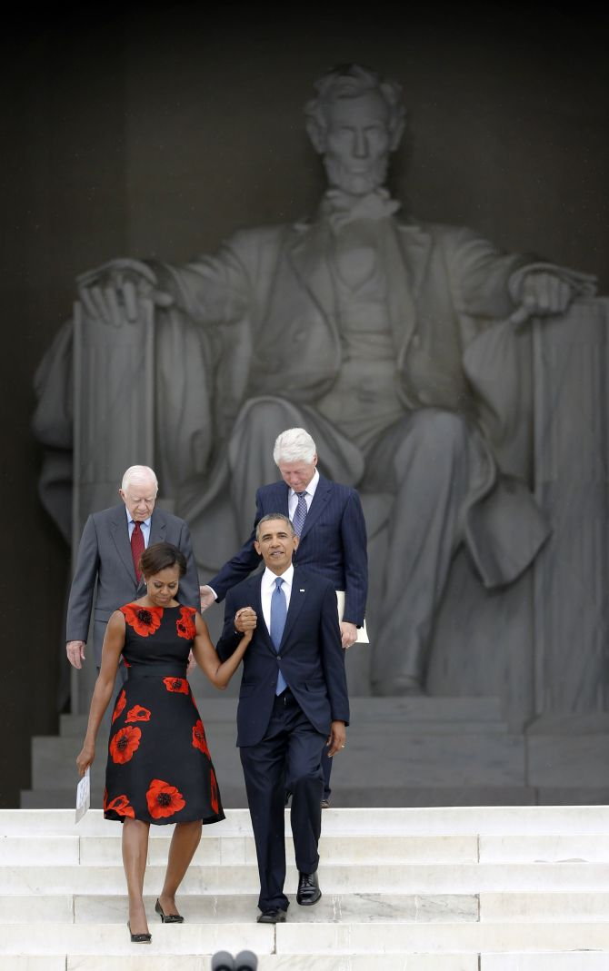 United States President Barack Obama leads first lady Michelle Obama and former presidents Jimmy Carter (L) and Bill Clinton during a ceremony marking the 50th anniversary of Martin Luther King's I have a dream speech on the steps of the Lincoln Memorial in Washington.