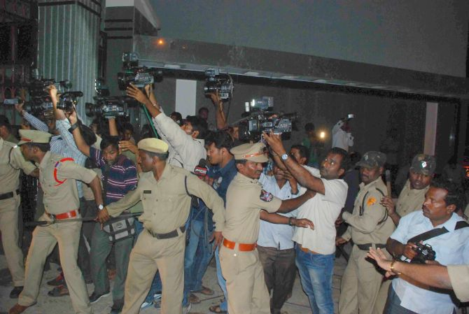 Police personnel try to disperse Jagan's supporters and mediapersons at the Osamania hospital