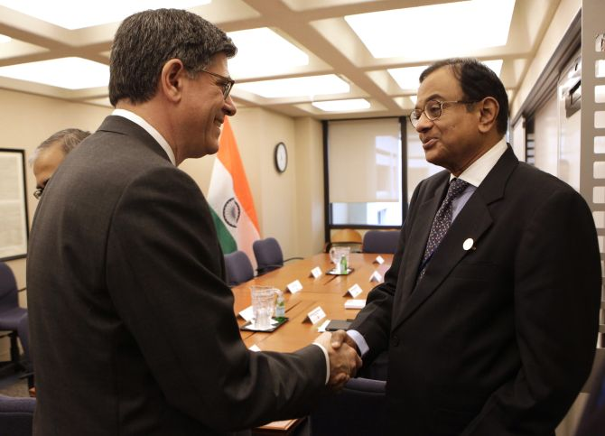 Finance Minister P Chidambaram, right, greets US Treasury Secretary Jack Lew..