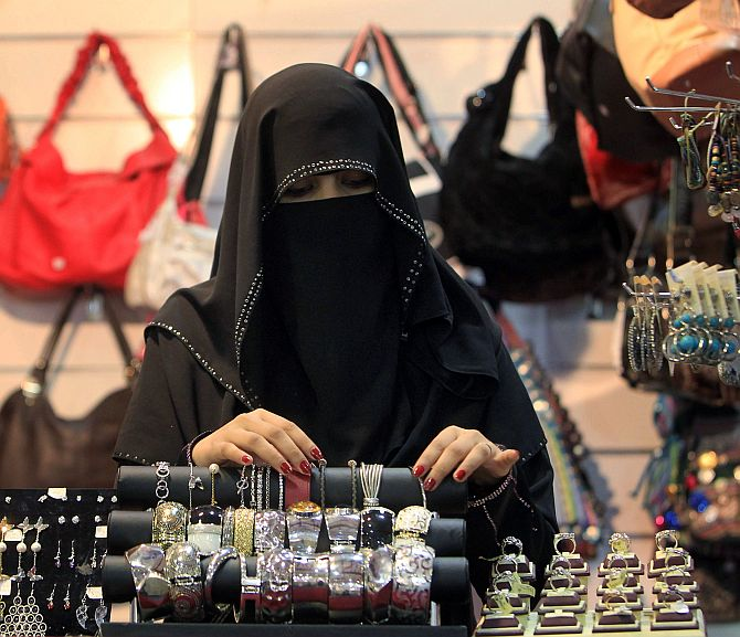 A vendor arranges jewellery at Abha Festival in Saudi Arabia