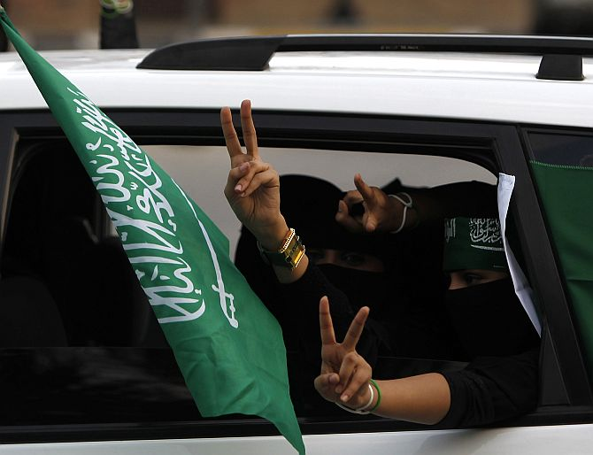 Saudi veiled women celebrate the country's National Day in Riyadh