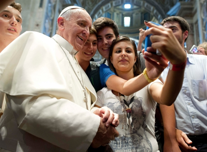 Even the Pope couldn't resist the temptation of a 'selfie'!