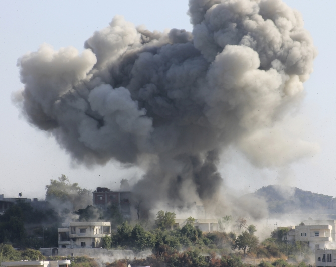 Smoke rises after what activists said was shelling by forces loyal to Syria's President Bashar al-Assad