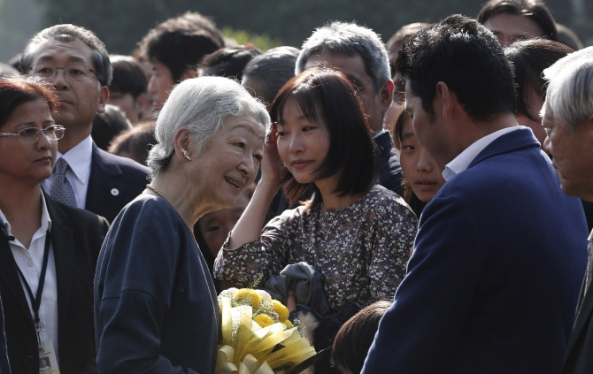 Japan's Empress Michiko interacts with guests during her visit to the Lodhi Gardens