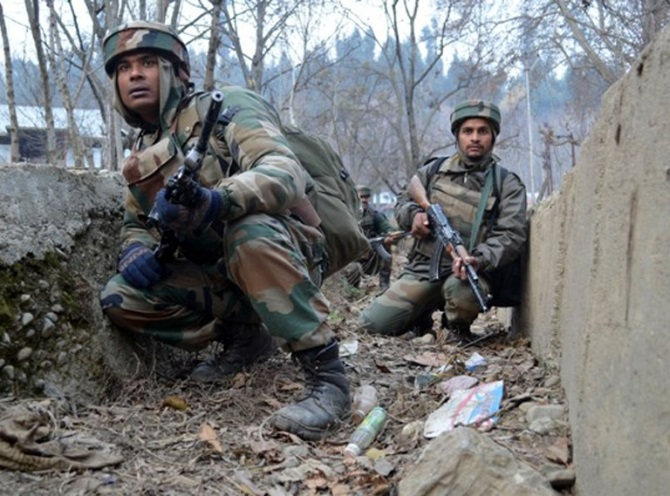 Army men take position near the house where militants were holed up