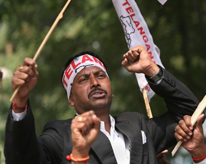 A pro-Telangana supporter shouts slogans during a protest in New Delhi