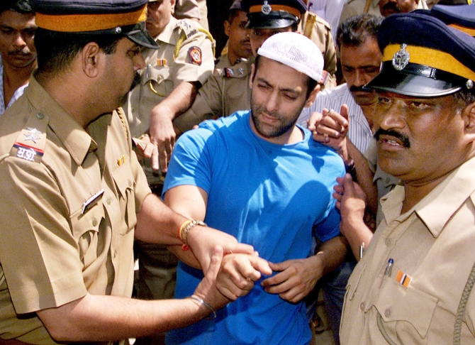 Salman Khan is escorted by police to a court in Mumbai on October 14, 2002