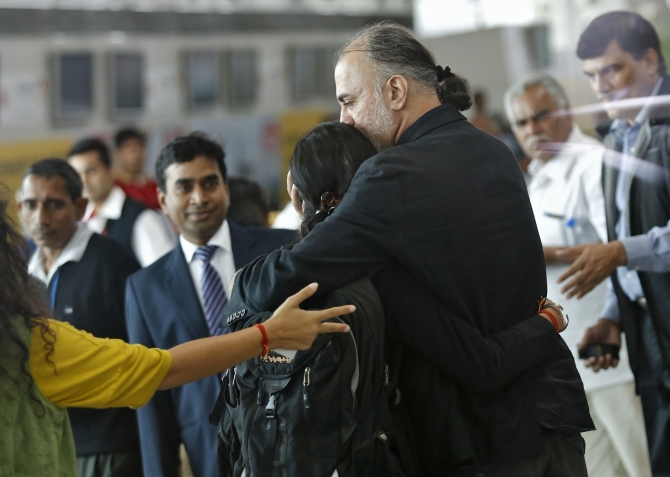 Tarun Tejpal, the 50-year-old founder and editor-in-chief of investigative magazine Tehelka, hugs an unidentified relative at the airport on his way to Goa, in New Delhi