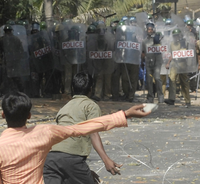 Pro-Telangana supporters throw stones towards police personnel during a protest near Osmania University