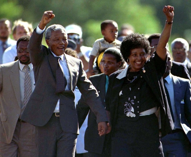 Nelson Mandela (front L), accompanied by his former wife Winnie, walks out of the Victor Verster prison, near Cape Town, after spending 27 years in apartheid jails on February 11, 1990.