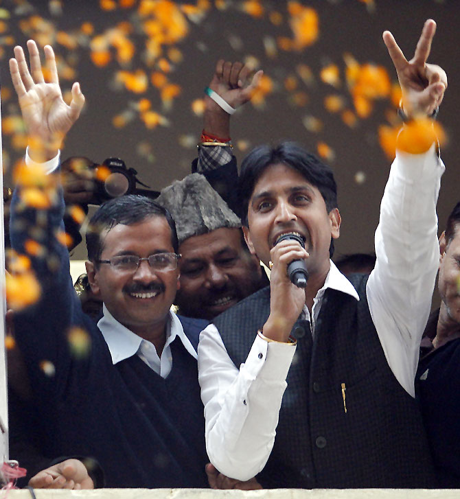 Arvind Kejriwal waves to his supporters