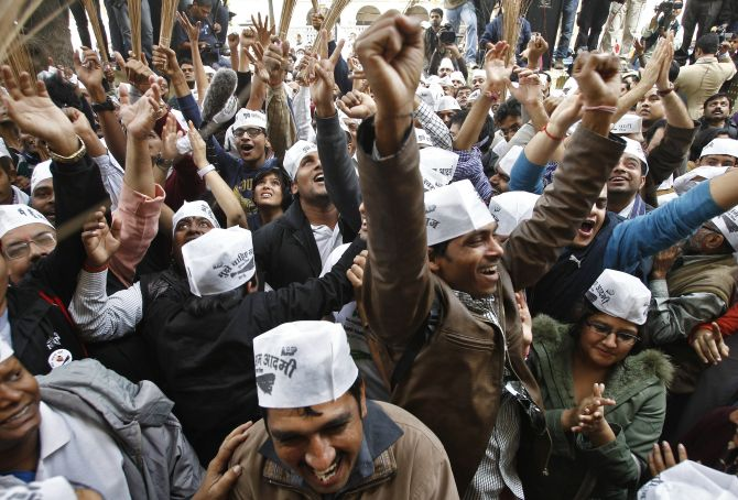 AAP supporters celebrate in Delhi on Monday