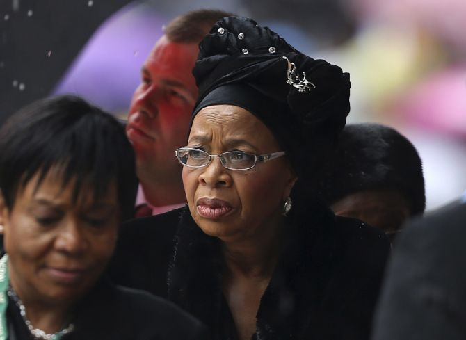 Former South African President Nelson Mandela's widow Graca Machel (C) arrives at the First National Bank (FNB) Stadium, also known as Soccer City, ahead of the national memorial service for Mandela in Johannesburg