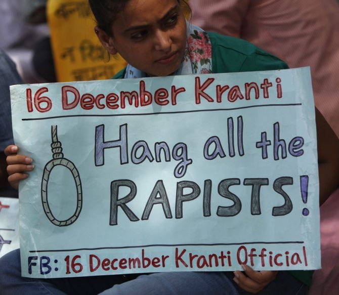 Protestors display placards during a demonstration seeking punishment for rapists, in New Delhi