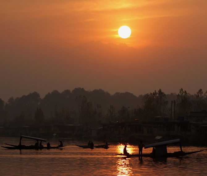 Tourists enjoying shikara rides on Dal Lake during sunset. Srinagar is yet to receive its first snowfall this season