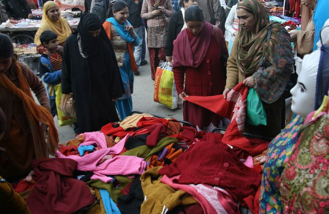 Women buying woollens at a market in Srinagar as winter sets in