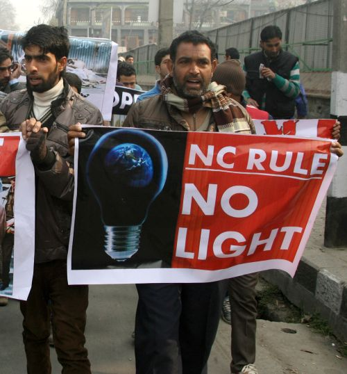 A protestor demonstrates against power woes in Srinagar