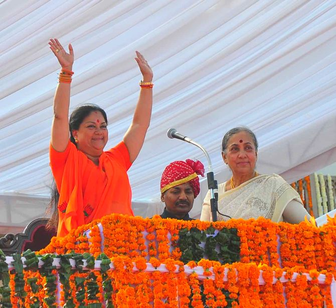 Vashundhara Raje waves to the crowd during her swearing-in ceremony as Rajasthan's CM, in Jaipur on Friday