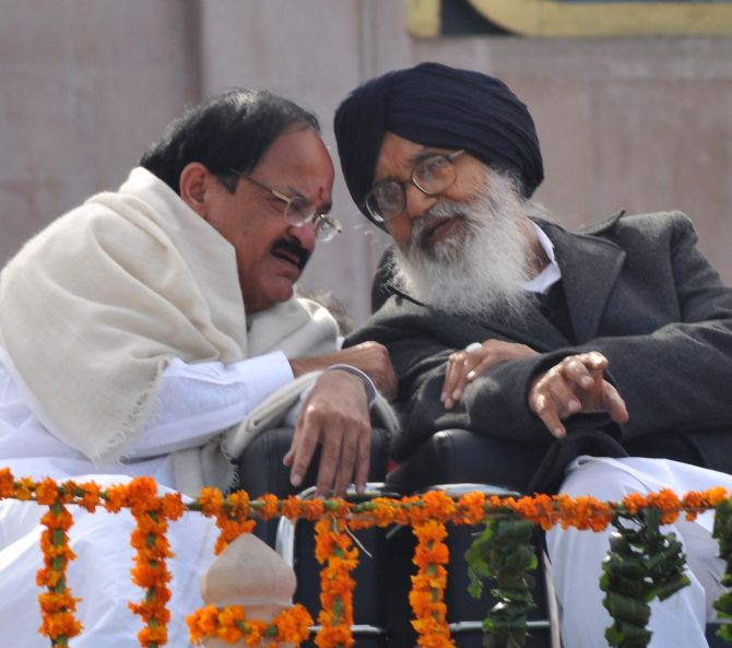 Punjab CM Parkash Singh Badal in a discussion with senior BJP leader Venkaiah Naidu, during the ceremony