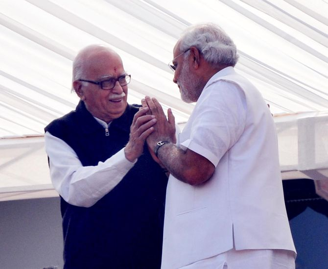 Narendra Modi greets senior BJP leader L K Advani during the swearing-in ceremony