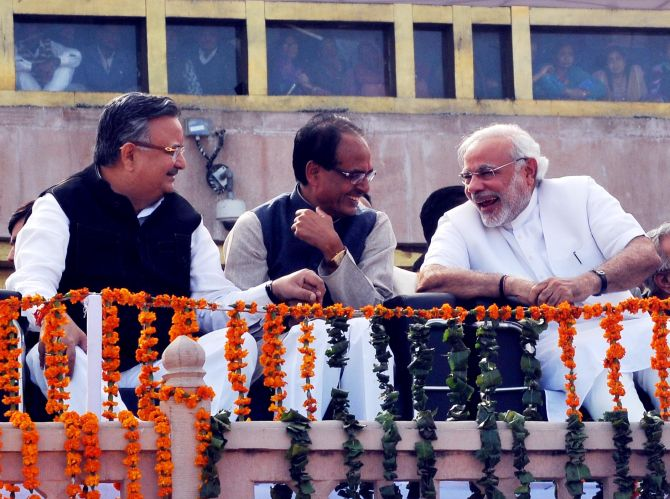 Narendra Modi shares a lighter moment with Shivraj Singh Chouhan and Raman Singh
