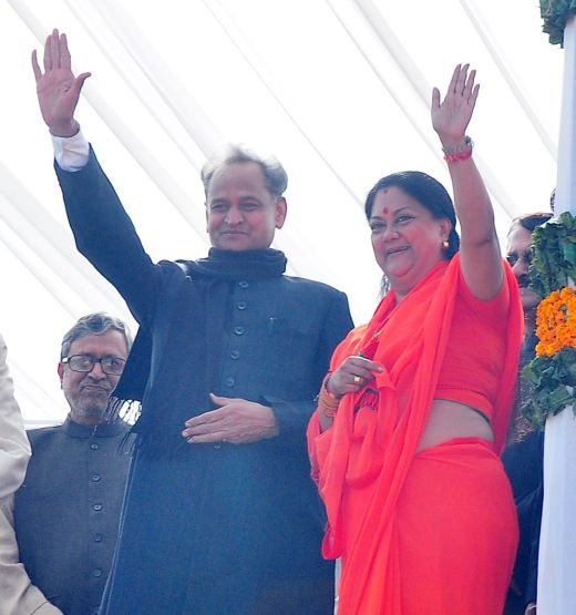 Vasundhara Raje waves to the crowd with former CM Ashok Gehlot