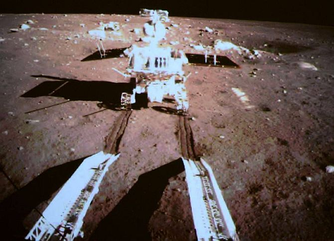 Moon rover Yutu, or Jade Rabbit, drives away from Chang'e 3 lander.