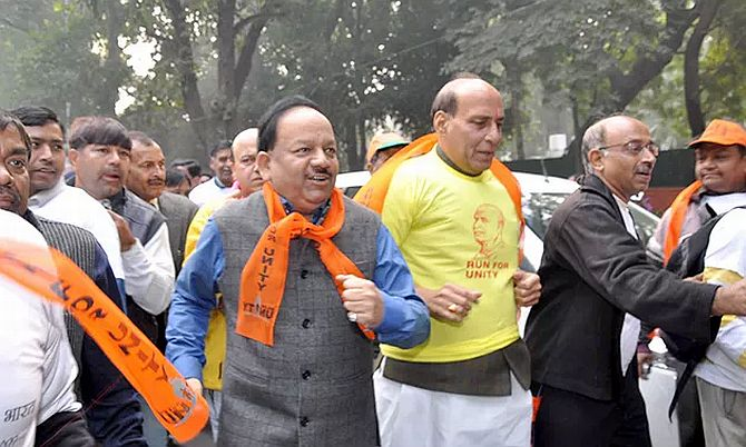 BJP President Rajnath Singh takes part in the Run for Unity in Delhi. Also seen are BJP leaders Harsh Vardhan and Vijay Goel