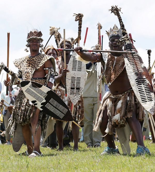 Zulu men perform a traditional dance on the hills above former South African President Nelson Mandela's home village during his state funeral
