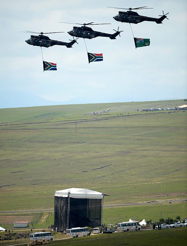 Military helicopters fly over the burial site where former South African President Nelson Mandela was buried on his family's property in his childhood village