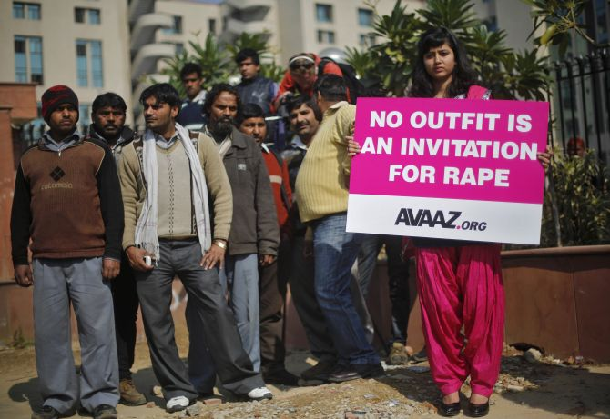 A demonstrator holds a placard during an anti-rape protest in New Delhi
