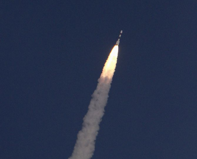 India's Polar Satellite Launch Vehicle, carrying the Mars orbiter, lifts off from the Satish Dhawan Space Centre in Sriharikota.