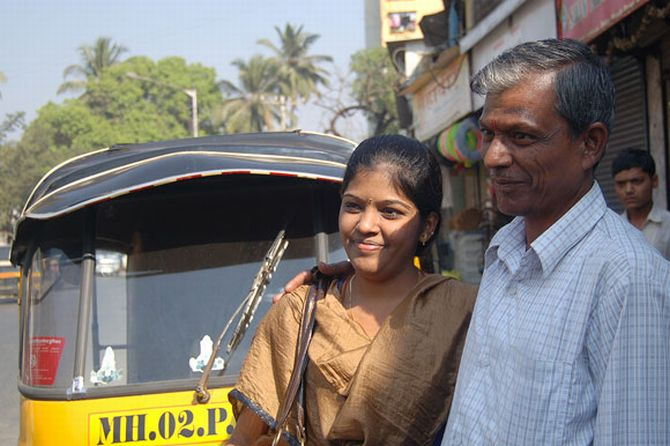 Jayakumar and Prema in front of the autorickshaw that Jayakumar drives.