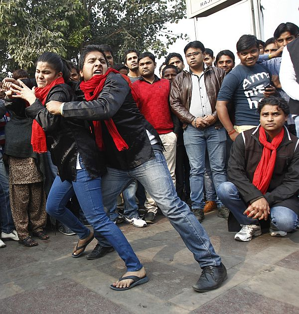 Demonstrators perform a street play on rape during a protest to mark the first anniversary of the Delhi gang rape