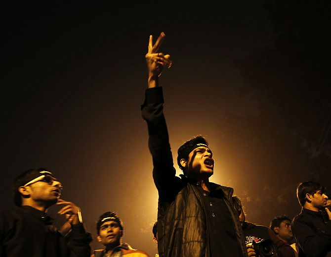 A protestor shouts slogans during a candle light vigil to mark the first anniversary of the Delhi gang rape