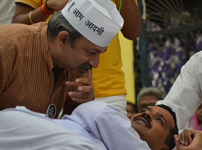 Mayank Gandhi, left, with Arvind Kejriwal.