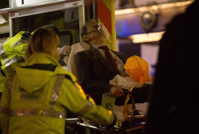 A man receives medical attention after part of the ceiling at the Apollo Theatre on Shaftesbury Avenue collapsed in central London.