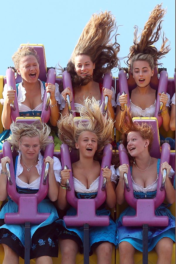 Girls enjoy a fairground ride during Oktoberfest 2013 beer festival at Theresienwiese on September 21, 2013 in Munich, Germany.