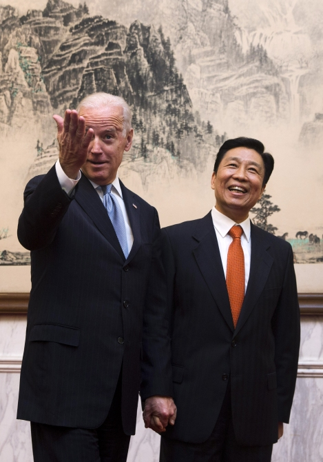 US Vice President Joe Biden shares a light moment with Chinese Vice Premier Li Yuanchao before their luncheon at the Diaoyutai State Guesthouse in Beijing in this picture taken on December 5, 2013