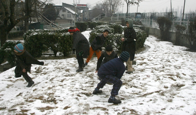 PHOTOS: Srinagar receives season's first snowfall