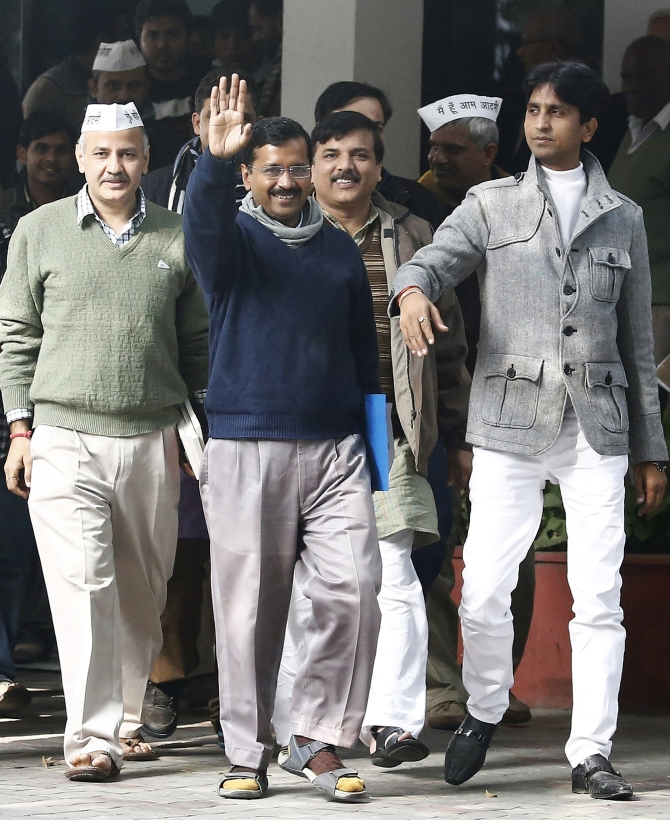 Arvind Kejriwal, leader of the Aam Aadmi Party, waves after his meeting with the Delhi's Lieutenant Governor Najeeb Jung in New Delhi