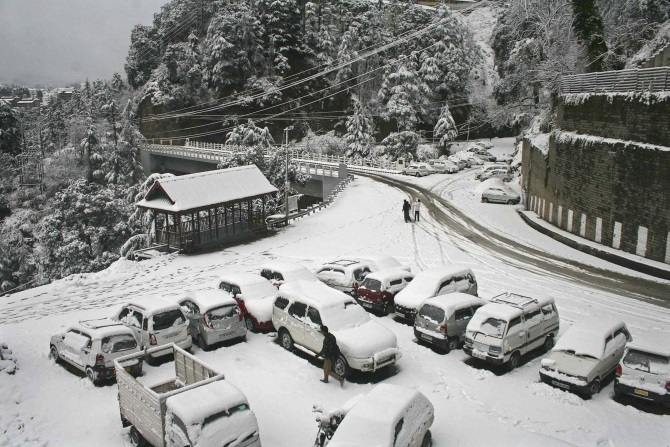 Snow covered cars in Shimla.