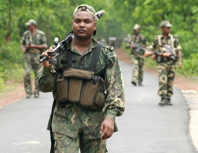 Paramilitary soldiers patrol near a Naxal-dominated village in Chhattisgarh