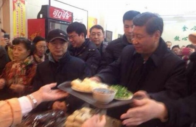 Chinese President Xi Jinping queues up at a bun joint in Beijing