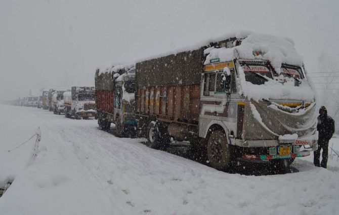 Trucks stranded outside Srinagar during heavy snowfall on Tuesday