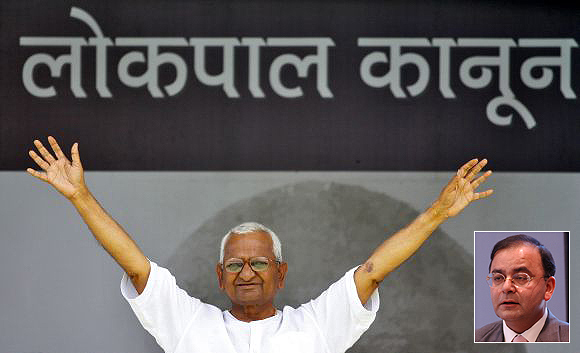 Social activist Anna Hazare waves to his supporters during a demonstration for strong Lokpal bill, at Ramlila Maidan in New Delhi (Inset) Arun Jaitley