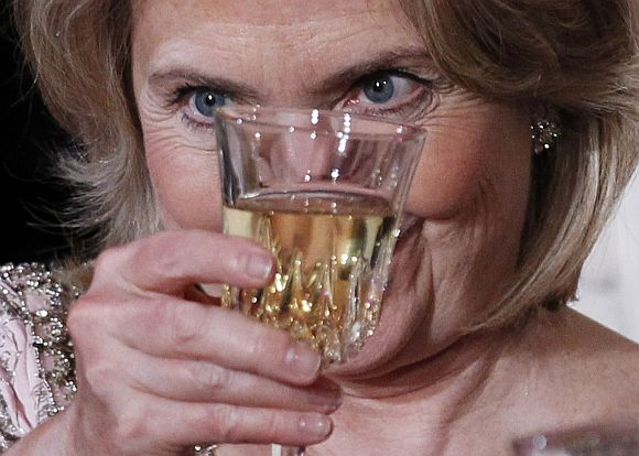 US Secretary of State Hillary Clinton raises her glass for a toast during a State Dinner