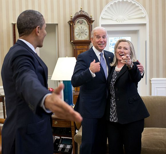Secretary of State Hillary Clinton had just accidentally dropped all of her briefing papers onto the Oval Office rug and she, the President and Vice President all reacted in a way that indicated that surely this photographer wouldn't get a photo of that to embarrass her