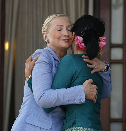 Hillary hugs Myanmar's pro-democracy leader Aung San Suu Kyi as they meet at Suu Kyi's house in Yangon December 2