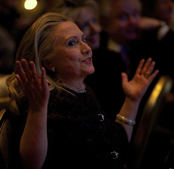 Hillary reacts as she watches a video highlighting her career at the 2012 Saban Forum on U.S.-Israel Relations gala dinner at the Willard Intercontinental Hotel in Washington, November 30, 2012